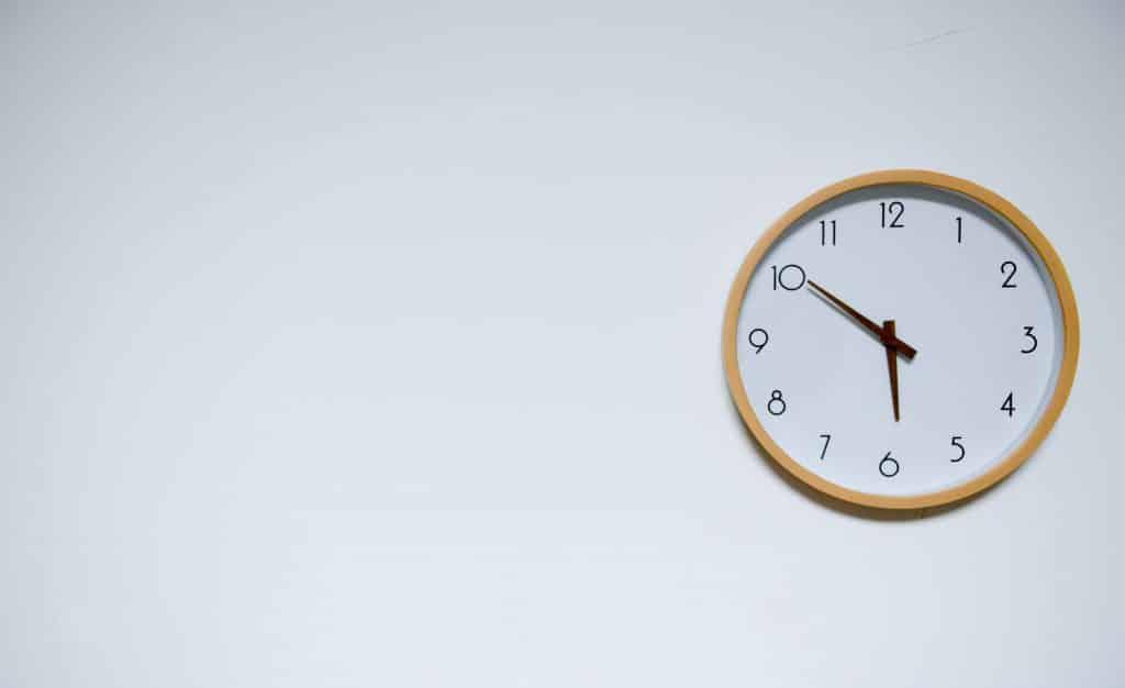 white-wall-clock-at-5-50