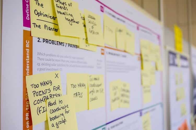 A planning board with sticky notes with marketing ideas.